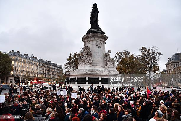 Supporters of women rights unions hold a demonstration for equal pay between men and women at Republique Square in Paris on November 7 2016