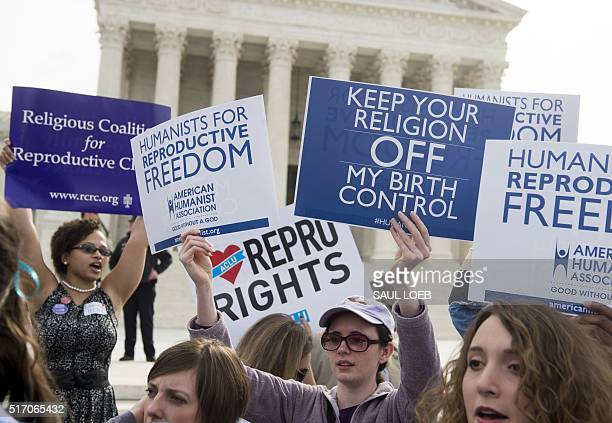 Supporters of women's health rally outside the Supreme Court in Washington DC March 23 as the Court hears oral arguments in 7 cases dealing with...