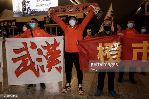 Supporters of Wuhan Zall football team welcome the team when they arrive arrive at Wuhan railway station on April 18 2020 in Hubei China The Wuhan...
