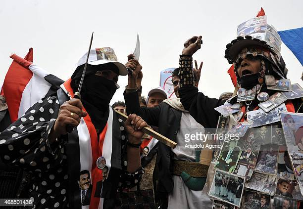 Supporters of Yemeni former President Ali Abdullah Saleh take part in a protest against Saudiled operations at AlTahrir Square in Sanaa Yemen on...