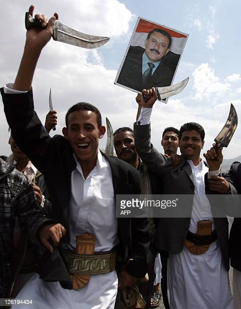 Supporters of Yemeni President Ali Abdullah Saleh raise their daggers during a rally in a main square in Sanaa on September 23 2011 to celebrate his...