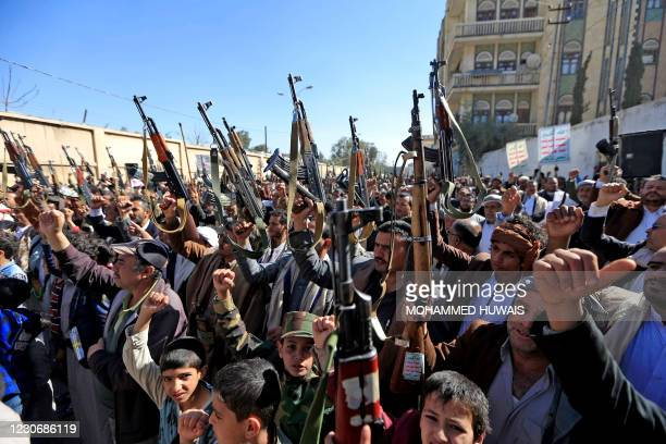 Supporters of Yemen's Huthi movement gesture as they chant slogans during a demonstration against the outgoing US administration's decision to...
