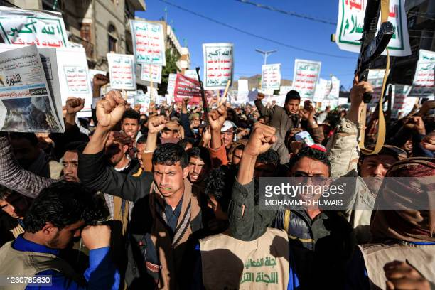 Supporters of Yemen's Huthi rebels attend a rally denouncing the United States and the outgoing Trump administration's decision to apply the...