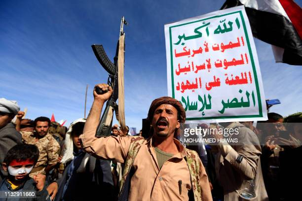 Supporters of Yemen's Huthi rebels attend a rally marking the fourth anniversary of the Saudi-led coalition's intervention in Yemen, in the capital...