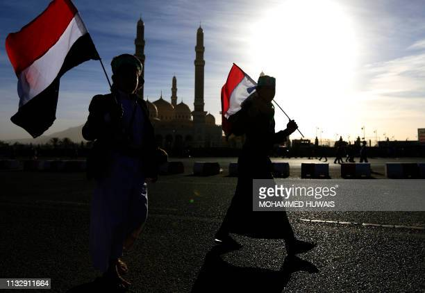 TOPSHOT Supporters of Yemen's Huthi rebels attend a rally marking the fourth anniversary of the Saudiled coalition's intervention in Yemen in the...