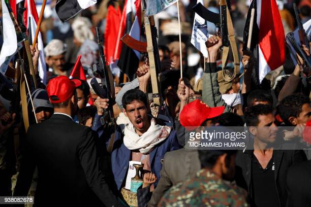 TOPSHOT Supporters of Yemen's Huthi rebels attend a rally to mark three years of war on the country in the capital Sanaa on March 26 2018 A Saudiled...