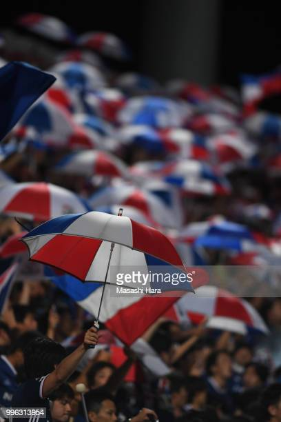 Supporters of Yokohama FMarinos celebrate the win after the Emperor's Cup third round match between Yokohama FMarinos and Yokohama FC at Nippatsu...