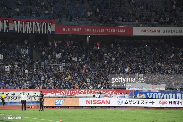 Supporters of Yokohama FMarinos show the banner in support of his coach Ange Postecoglou after the JLeague J1 match between Yokohama FMarinos and...