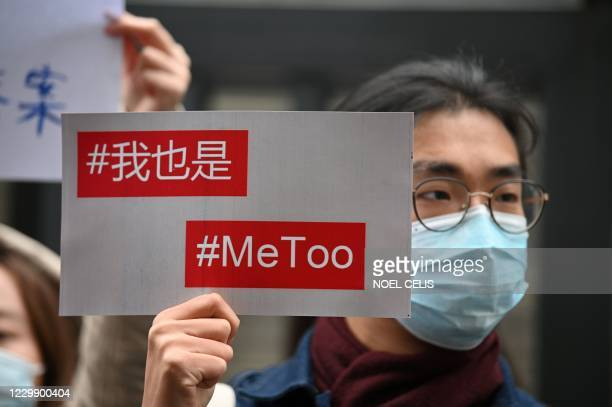 Supporters of Zhou Xiaoxuan, a feminist figure who rose to prominence during Chinas #MeToo movement two years ago, display posters outside the...