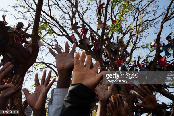 Supporters of Zimbabwe's opposition party, the Movement for Democratic Change , gather at a field in Harare for Morgan Tsvangirai's final rally, on...