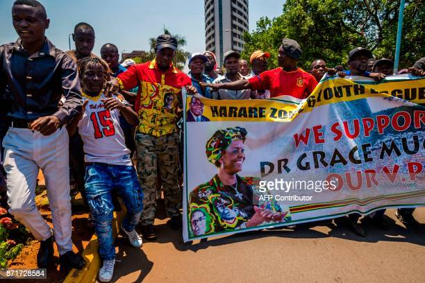 Supporters of Zimbabwe's President gather at his party headquarters to show support to Grace Mugabe becoming the party's next Vice President after...