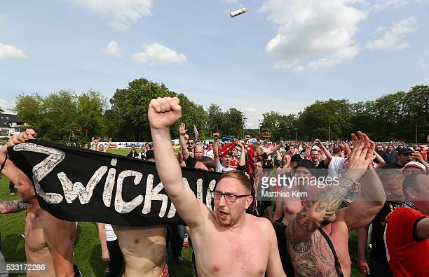 Supporters of Zwickau celebrate their team after winning the Regionalliga Nordost championship title after the Regionalliga Nordost match between FC...