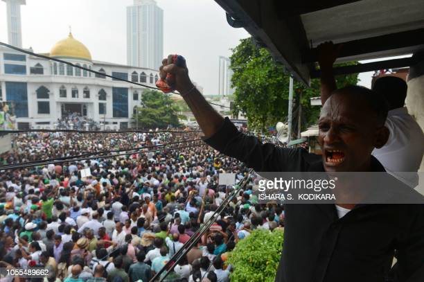A supporters ousted of Sri Lanka's Prime Minister Ranil Wickremesinghe shouts slogans during a protest against his removal near the Prime Minister's...