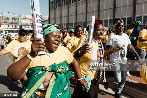 Supporters parade on their way to attend the African National Congress 107th anniversary celebrations at the Moses Mabhida Stadium in Durban on...