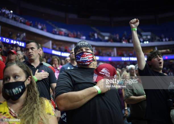 Supporters participate in the Pledge of Allegiance during a campaign rally for U.S. President Donald Trump at the BOK Center, June 20, 2020 in Tulsa,...