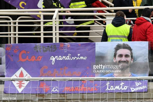 Supporters pay tribute to late Fiorentina's captain Davide Astori with a banner reading 'Thanks great Captain we miss you' on March 11 2018 during...