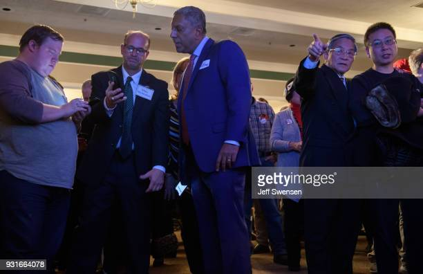 Supporters peruse early election results at an Election Night event for GOP PA Congressional Candidate Rick Saccone as the polls close on March 13...