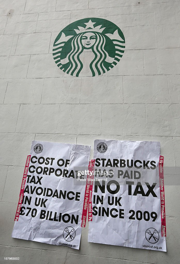 UK UNCUT supporters placed posters on a sidewall of a Starbucks coffee shop near Regent Street on December 8, 2012 in London, England. UK UNCUT are holding a day of protests at various Starbucks throughout the United Kingdom after the coffe chain were revealed to be paying almost no corporation tax.