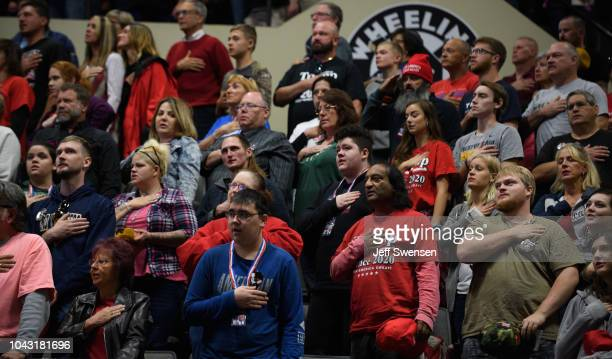 Supporters pledge allegiance to the flag at a rally for President Donald J Trump inside the WesBanco Arena on September 29 2018 in Wheeling West...