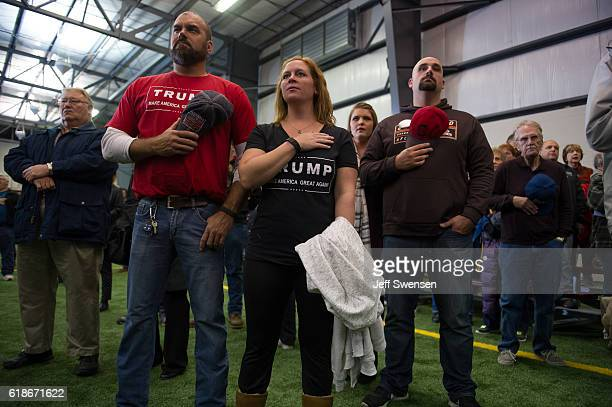Supporters pledge allegiance to the flag before Republican presidential nominee Donald Trump speaks at a campaign rally on October 27 2016 at the...