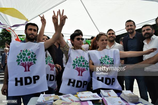 Supporters pose for a photo during the opening of a new election campaign booth of the proKurdish Peoples' Democractic Party for the early...
