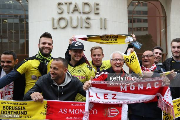 Supporters pose prior to the UEFA Champions League football match AS Monaco FC against BV 09 Borussia Dortmund on April 19 2017 in front of the Louis...