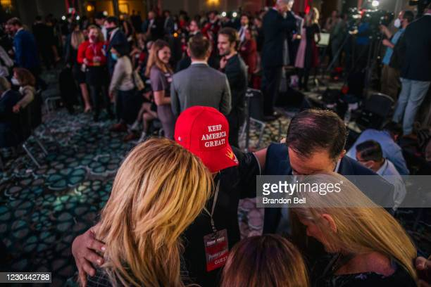 Supporters pray during a run-off election night party at Grand Hyatt Hotel in Buckhead on January 5, 2021 in Atlanta, Georgia. Voters in Georgia...