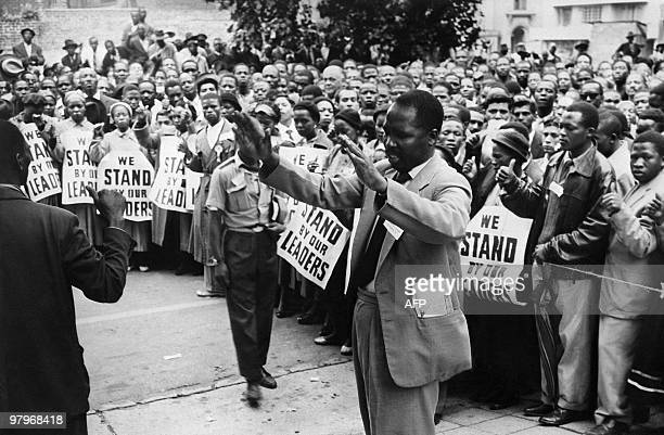 ANC supporters pray in front of the courthouse of Johannesburg 28 December 1956 to support 152 antiapartheid militants in which Nelson Mandela during...