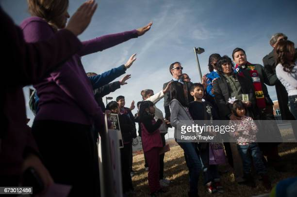 Supporters pray over Jeanette Vizguerra before she met with immigration authorities Vizguerra's stay of deportation to Mexico expired Feb 1 She's...