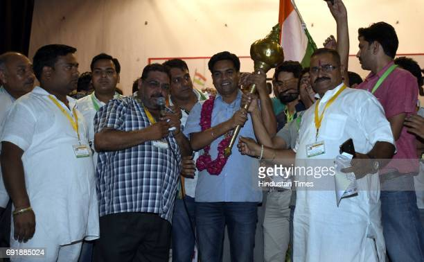 Supporters present Mace to former Delhi Minister Kapil Mishra during the launch of programme 'India Against Corruption2' against Arvind Kejriwal's...