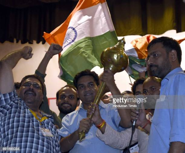 Supporters present Mace to former Delhi Minister Kapil Mishra during the launch of programme 'India Against Corruption-2' against Arvind Kejriwal's...