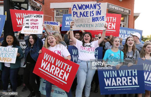Supporters presidential candidate Sen. Elizabeth Warren rally near the perimeter of the fourth Democratic presidential debate October 14, 2019 in...