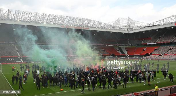 Supporters protest against Manchester United's owners, inside English Premier League club Manchester United's Old Trafford stadium in Manchester,...