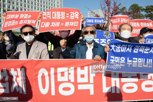 Supporters protesting against former South Korean president Lee Myung-bak's confirmation of his 17-year prison sentence protest in front of the Seoul...