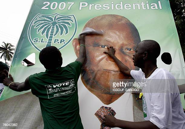 Supporters put up a banner of Sierra Leone's current vice president Solomon Berewa during an election campaign rally in Freetown 09 August 2007...