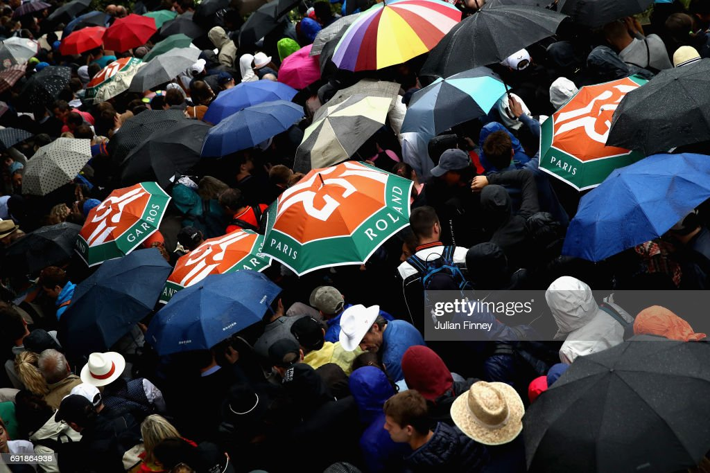 Supporters put up their umbrellas to take cover from the rain on day seven of the 2017 French Open at Roland Garros on June 3, 2017 in Paris, France.