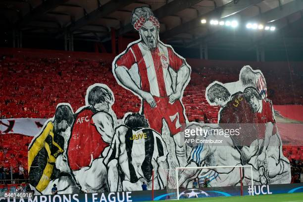 Supporters raise a tableau of players during the Group D UEFA Champions League football match between Olympiacos and Sporting Lisbon at The...