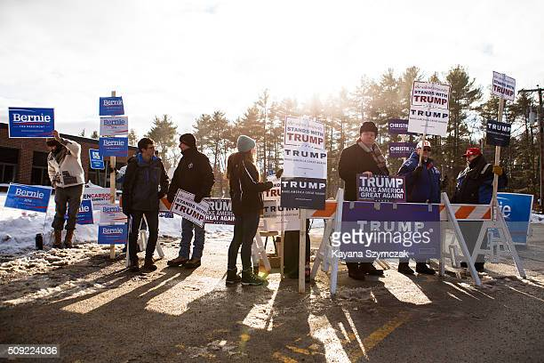 Supporters rally for their chosen candidate outside of the voting place at Merrimack High School on primary day February 9 in Merrimack New Hampshire...