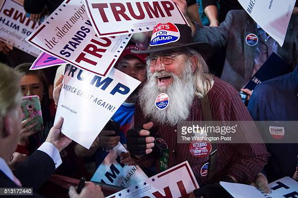 Supporters reach for signatures handshakes and photos as republican presidential candidate Donald Trump greets the crowd after speaking at a campaign...