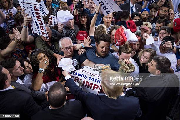 Supporters reach for signatures handshakes and photos as republican presidential candidate Donald Trump greets the crowd after speaking during a...