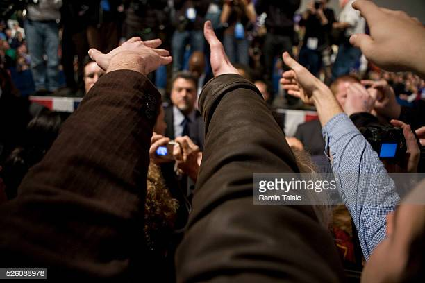 Supporters reach in to shake hands with Democratic presidential hopeful Senator Barack Obama, during a rally at the Nashua South High School. Obama...
