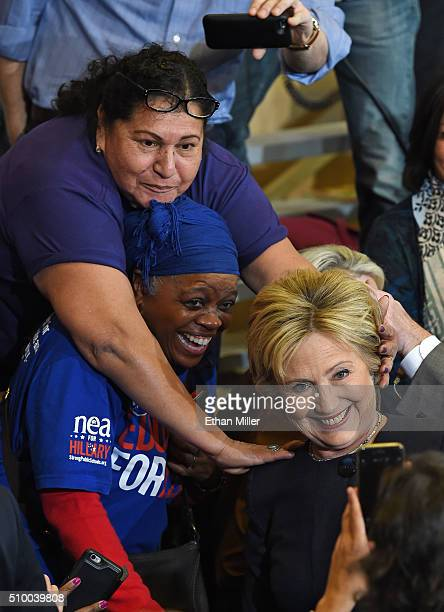 Supporters reach out to Democratic presidential candidate Hillary Clinton as she takes photos after speaking at a getoutthecaucus event on February...