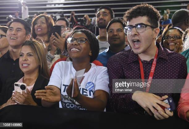 Supporters react as former US President Barack Obama speaks during a getoutthevote rally at the Cox Pavilion as he campaigns for Nevada Democratic...