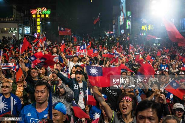 Supporters react as Han Kuo-Yu, presidential candidate for Taiwan's main opposition Kuomintang party, joins his supporters after losing the Taiwan...