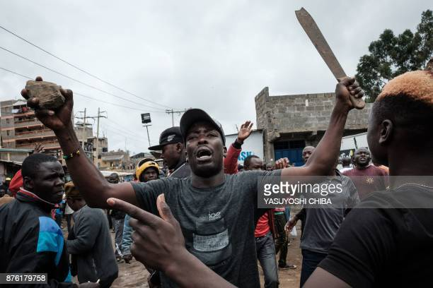 TOPSHOT Supporters react as Kenya's opposition party National Super Alliance leader arriving at Riverside slum in Nairobi on November 19 2017 Four...