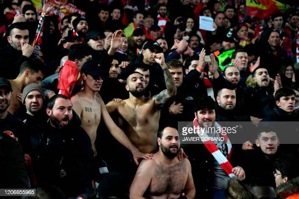 Supporters react at the final whistle during the UEFA Champions league Round of 16 second leg football match between Liverpool and Atletico Madrid at...