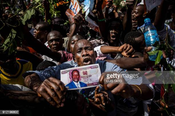 TOPSHOT Supporters react before the Kenyan opposition National Super Alliance coalition leader has himself sworn in as the 'people's president' on...