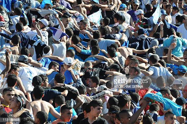 Supporters react during the match opposing Athletico Madrid to Raja de Casablanca at the new stadium in Tangier on April 26 2011 AFP PHOTO/ ABDELHAK...