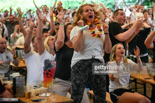 Supporters react during the UEFA EURO 2020 round of 16 football match between England and Germany at the Grugapark in Essen, western Germany, on June...