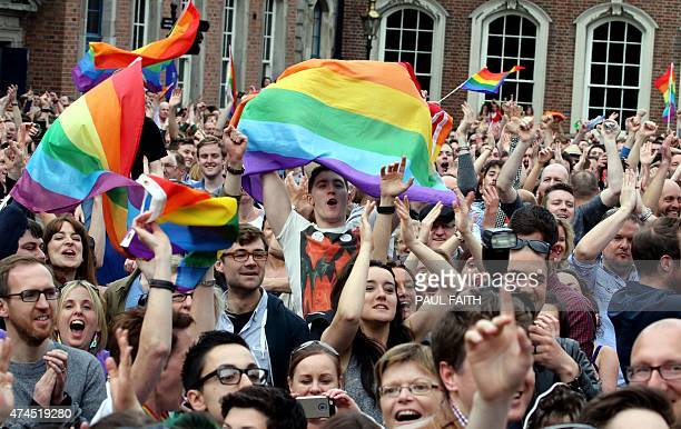 Supporters react outside Dublin Castle following the announcement of the result of the samesex marriage referendum in Dublin on May 23 2015 Ireland...